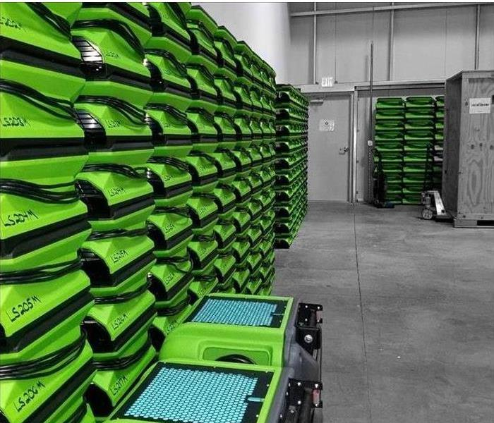 hundreds of green air movers stacked on top of each other